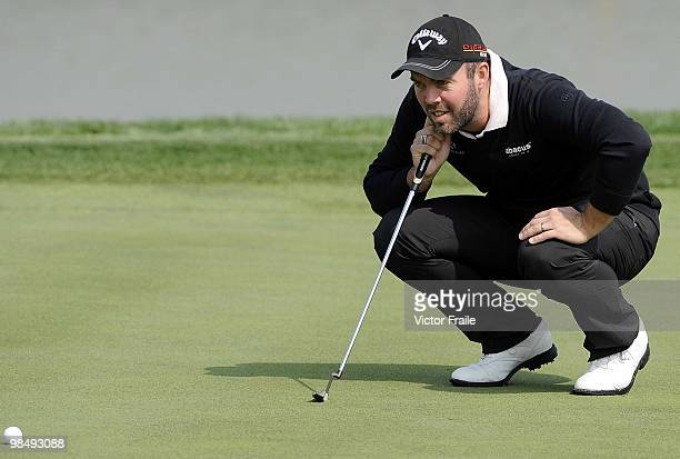 Christian Nilsson of Sweden lines up a putt on the 9th hole during the Round Two of the Volvo China Open on April 16, 2010 in Suzhou, China.
