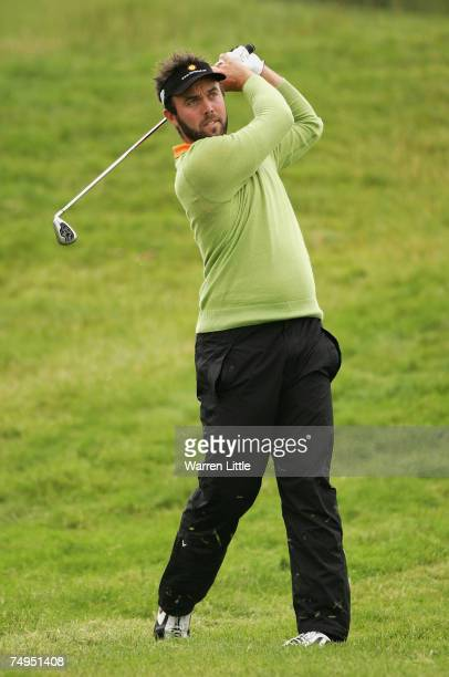Christian Nilsson of Sweden plays his second shot into the 18th green during the second round of The Open de France ALSTOM at the Le Golf National...