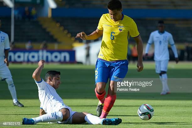 Christian Noboa of Ecuador fights for the ball with Emilio Izaguirre of Honduras during a friendly match between Ecuador and Honduras at Olímpico...