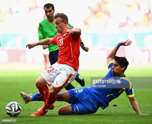 Christian Noboa of Ecuador tackles Xherdan Shaqiri of Switzerland during the 2014 FIFA World Cup Brazil Group E match between Switzerland and Ecuador...