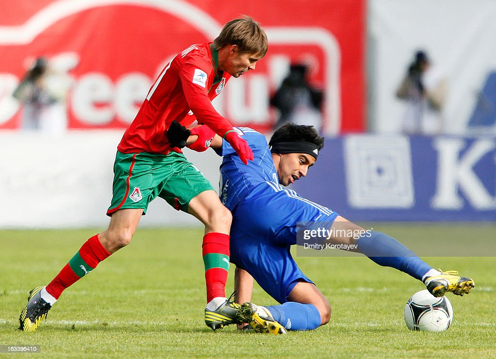 Christian Noboa of FC Dynamo Moscow (R) and Dmitri Torbinski of FC Lokomotiv Moscow in action during the Russian Premier League match between FC Dynamo Moscow and FC Lokomotiv Moscow at the Arena Khimki Stadium on March 09, 2013 in Khimki, Russia.