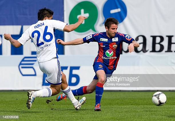 Christian Noboa of FC Dynamo Moscow and Zoran Tosic of PFC CSKA Moscow vie for the ball during the Russian Football League Championship match between...