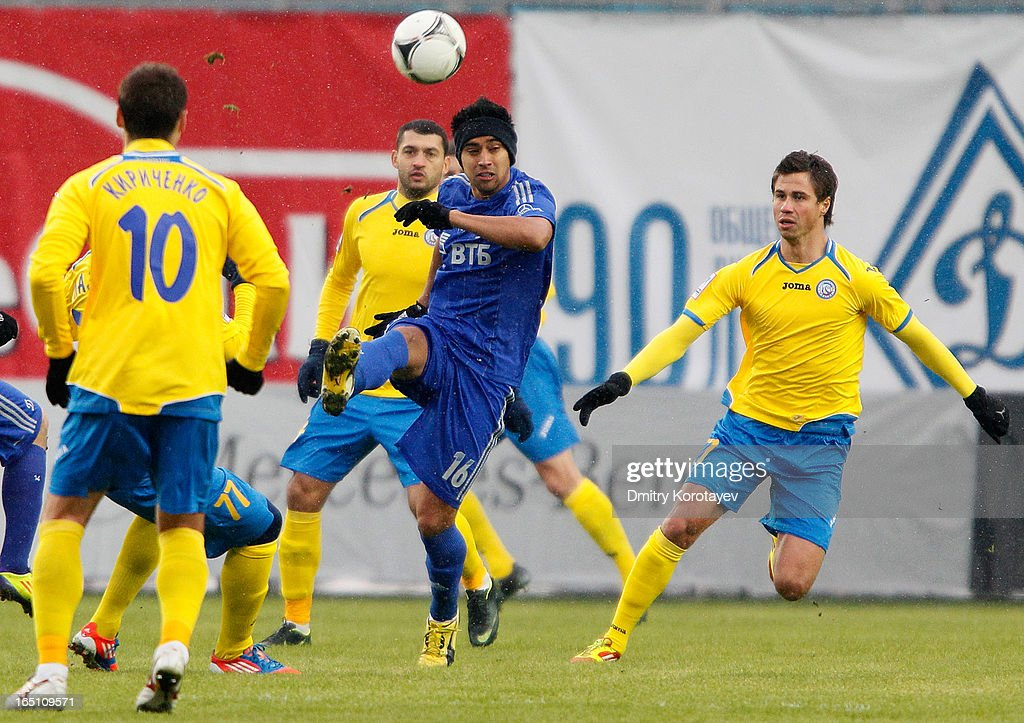 Christian Noboa (C) of FC Dynamo Moscow in action against Aleksandr Sheshukov (R) of FC Rostov Rostov-on-Don during the Russian Premier League match between FC Dynamo Moscow and FC Rostov Rostov-on-Don at the Arena Khimki Stadium on March 30, 2013 in Khimki, Russia.
