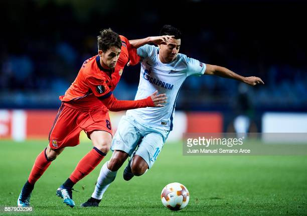 Christian Noboa of Zenit St Petersburg duels for the ball with Adnan Januzaj of Real Sociedad during the UEFA Europa League group L football match...