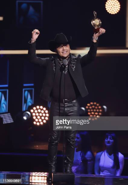 Christian Nodal accepts an award on stage at Univision's 31st Edition Of Premio Lo Nuestro A La Musica Latin at American Airlines Arena on February...