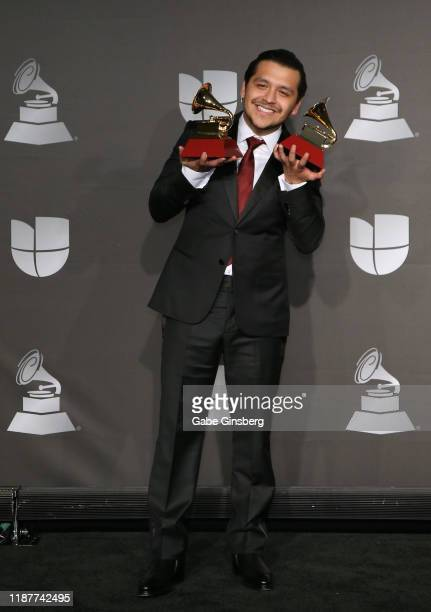 Christian Nodal poses with the Best Ranchero/Mariachi Album and Best Regional Song awards in the press room during the 20th annual Latin GRAMMY...