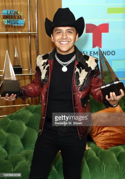 Christian Nodal winner of the Favorite Regional Mexican Artist award and Favorite Regional Mexican Album award for 'Me Deje Llevar' poses in the...