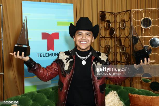 Christian Nodal winner of the Favorite Regional Mexican Artist award and Favorite Regional Mexican Album award for 'Me Deje Llevar' poses in the...