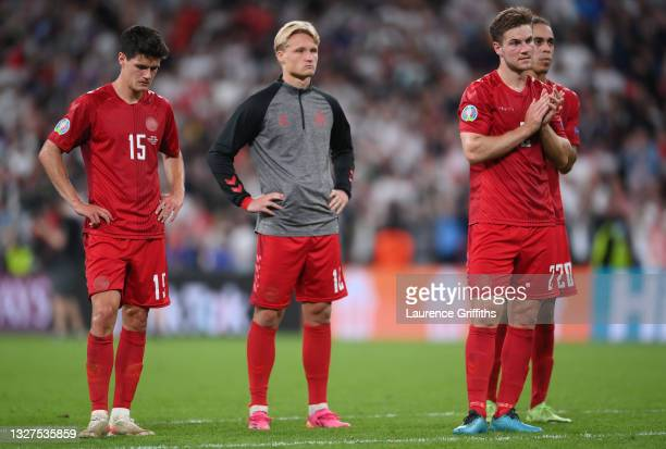 Christian Norgaard, Kasper Dolberg, Joachim Andersen and Yussuf Poulsen of Denmark look dejected as they acknowledge the fans after the UEFA Euro...