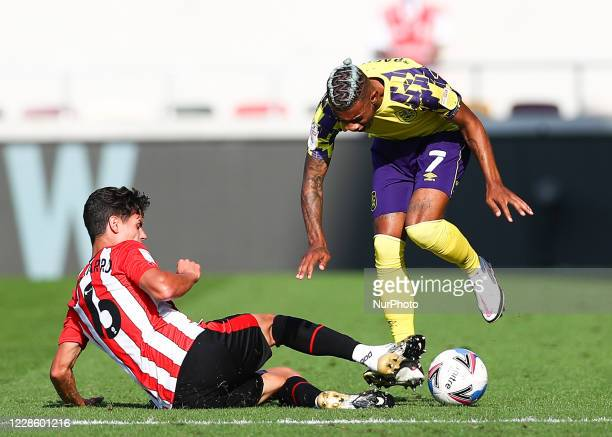 Christian Norgaard of Brentford battling for possession wiyh Juninho Bacuna of Huddersfield Town during the Sky Bet Championship match between...