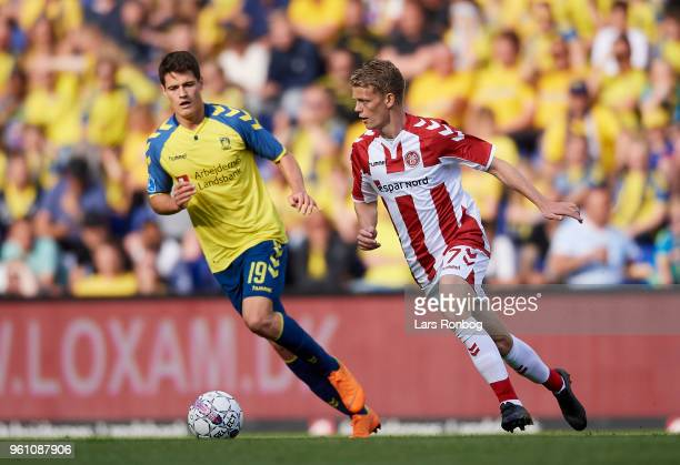 Christian Norgaard of Brondby IF and Kasper Kusk of AaB Aalborg compete for the ball during the Danish Alka Superliga match between Brondby IF and...