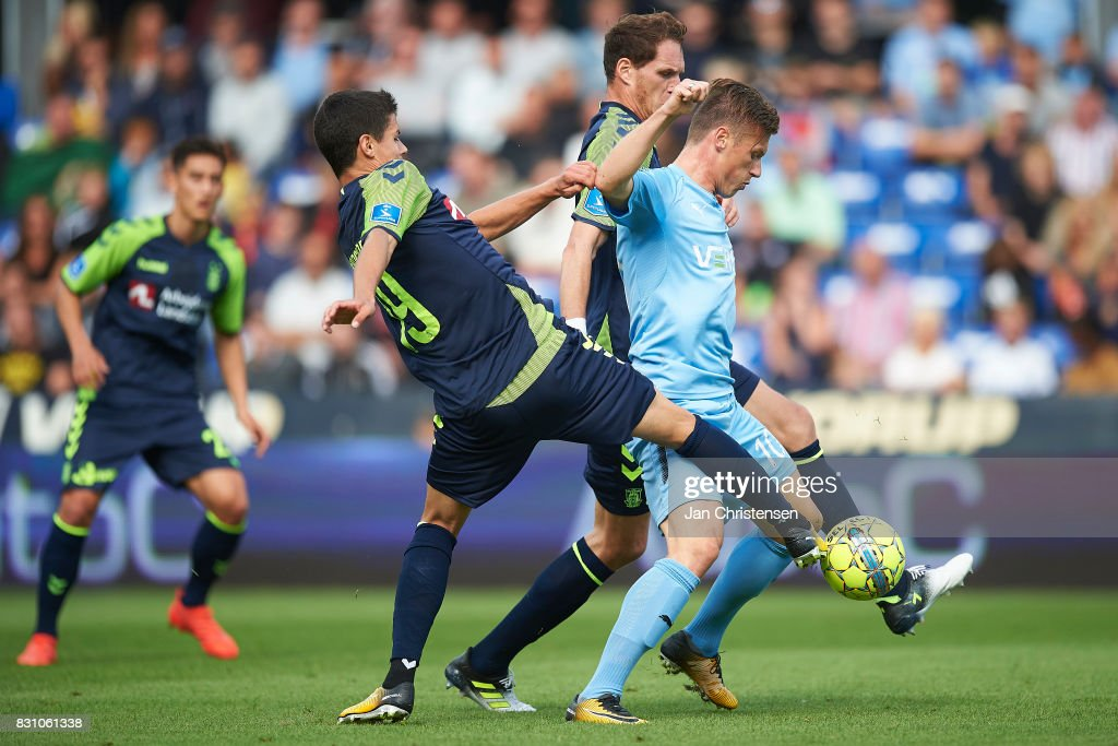 Christian Norgaard of Brondby IF and Marvin Pourié of Randers FC compete for the ball during the Danish Alka Superliga match between Randers FC and Brondby IF at BioNutria Park Randers on August 13, 2017 in Randers, Denmark.