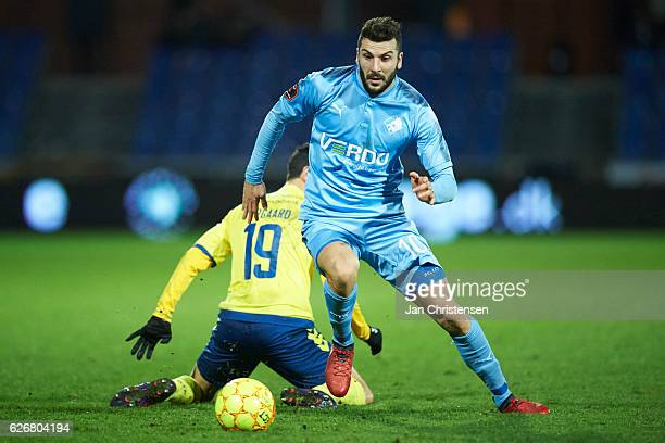 Christian Norgaard of Brondby IF and Mikael Ishak of Randers FC compete for the ball during the Danish Alka Superliga match between Randers FC and...