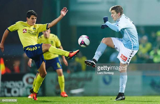 Christian Norgaard of Brondby IF and Mikael Uhre of Sonderjyske compete for the ball during the Danish Alka Superliga match match between Sonderjyske...