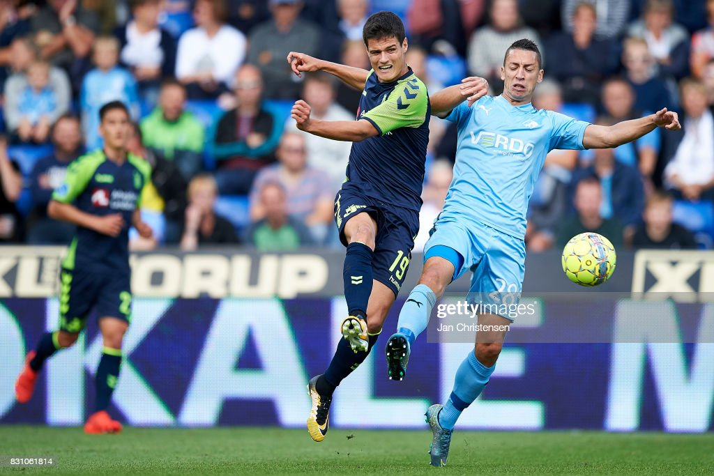 Christian Norgaard of Brondby IF and Nikola Djurdjic of Randers FC compete for the ball during the Danish Alka Superliga match between Randers FC and Brondby IF at BioNutria Park Randers on August 13, 2017 in Randers, Denmark.