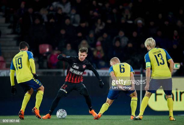 Christian Norgaard of Brondby IF Mikkel Duelund of FC Midtjylland and Hjortur Hermannsson of Brondby IF compete for the ball during the Danish Alka...