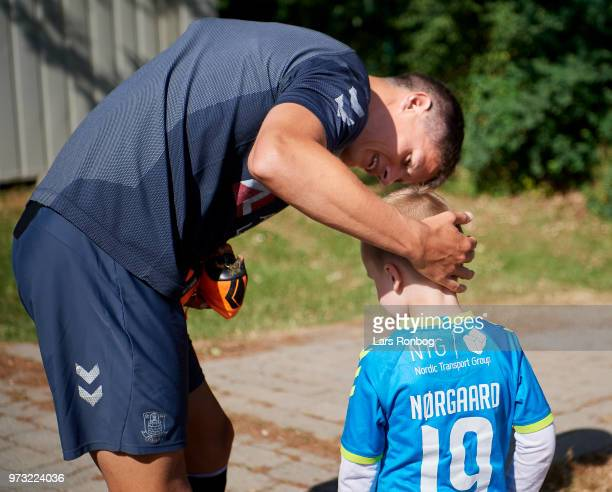 Christian Norgaard of Brondby IF signing an autograph for an young fan prior to the Brondby IF training session at Brondby Stadion on June 13 2018 in...