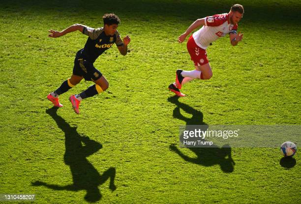 Christian Norton of Stoke City battles for possession with Tomas Kalas of Bristol City during the Sky Bet Championship match between Bristol City and...