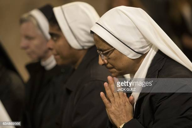 Christian nuns attend a mass at the Church of the Multiplication of the Loaves and Fish in Tabgha on February 12 upon it's reopening following eight...