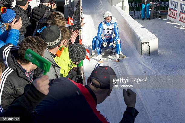Christian Oberstolz and Patrick Gruber of Italy react after their run in the Sprint Mens Double Final of the FILSprint World Championships at...