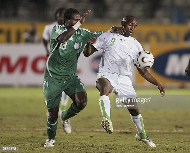 Christian Ododo of Nigeria and Souleymane Camara of Senegal in action during The African Cup of Nations Third Place Playoff match between Senegal v...