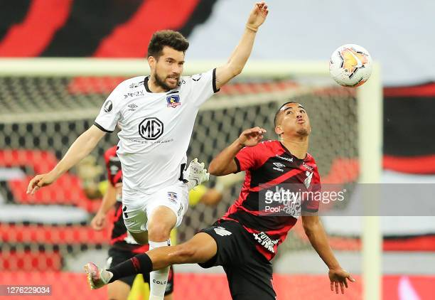 Christian of Athletico Paranaense fights for the ball with Cesar Fuentes of ColoColo during a group C match of Copa CONMEBOL Libertadores 2020...