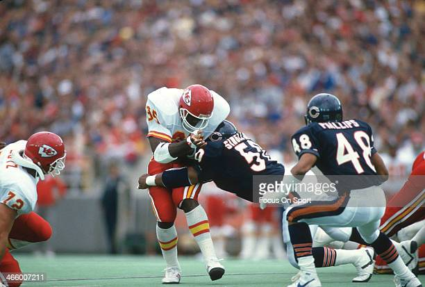 Christian Okoye of the Kansas City Chiefs gets tackle by Mike Singletary of the Chicago Bears during an NFL football game December 29 1990 at Soldier...
