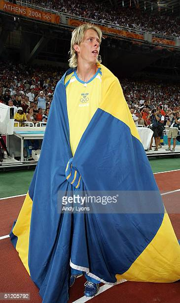 Christian Olsson of Sweden celebrates after he won the men's triple jump final on August 22 2004 during the Athens 2004 Summer Olympic Games at the...