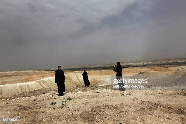 A Christian Orthodox nun takes a picture with the view of the Jordan valley desert at the Qasr alYahud baptismal site on April 14 2009 Thousands of...