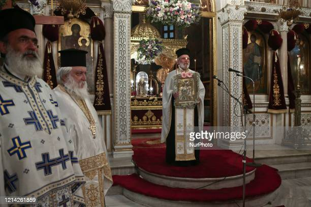 Christian Orthodox priests during a liturgy open for believers following the easing of measures against the spread of the coronavirus disease, at the...