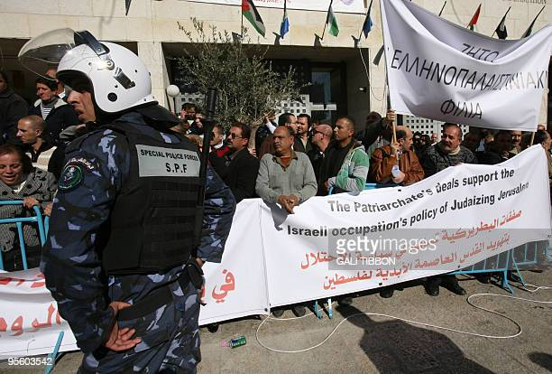 Christian Orthodox protesters hold signs in Greek Arabic and English accusing the Greek Orthodox Patriarch of Jerusalem Theophilos III of betraying...