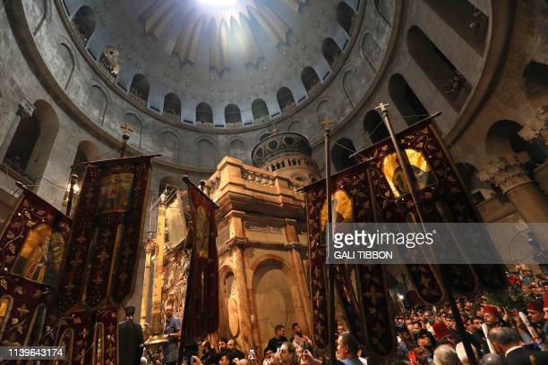 Christian Orthodox worshippers gather in the Church of the Holy Sepulchre in Jerusalems Old City as they await the Holy Fire on April 27 2019 during...