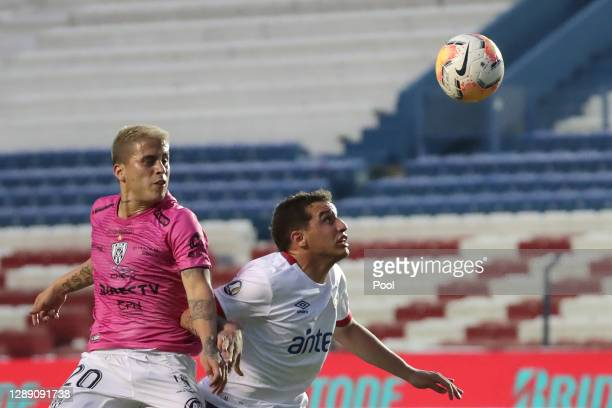 Christian Ortiz of Independiente del Valle competes for the ball with Joaquín Trasante of Nacional during a round of sixteen second leg match of Copa...