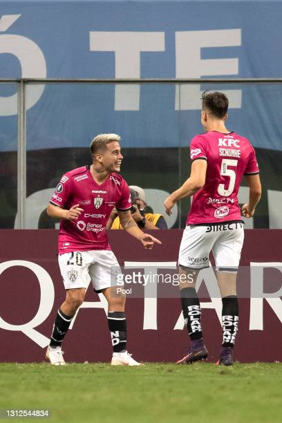 Christian Ortíz of Independiente del Valle celebrates with teammate Richard Schunke after scoring the first goal of his team during a third round...