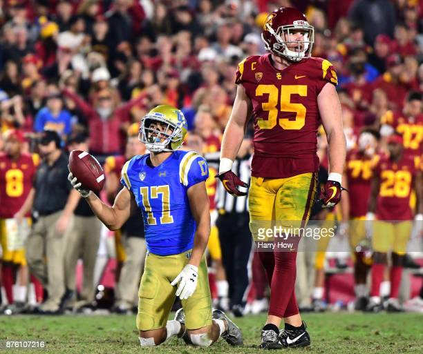 Christian Pabico of the UCLA Bruins reacts to his dropped pass in front of Cameron Smith of the USC Trojans during the fourth quarter at Los Angeles...