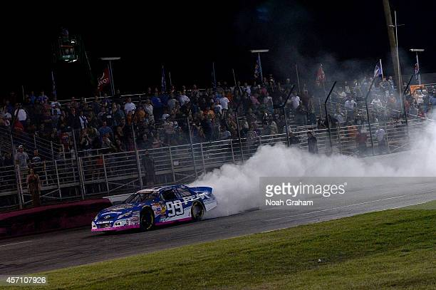 Christian PaHud driver of the PEAK Toyota celebrates after his victory in the NASCAR KN Toyota/NAPA Auto Parts 150 at the All American Speedway on...