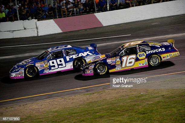 Christian PaHud driver of the PEAK Toyota drives past Brandon McReynolds driver of the NAPA Auto Parts Toyota during the NASCAR KN Toyota/NAPA Auto...