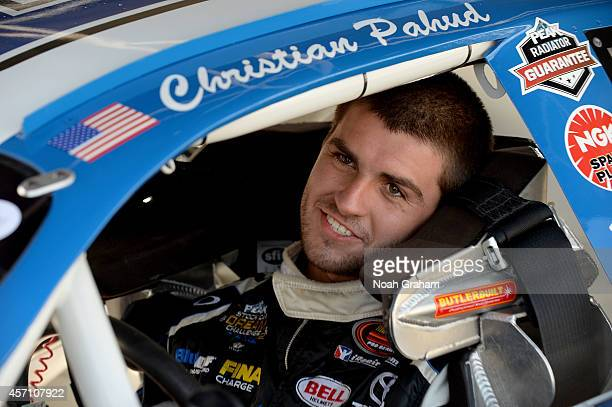 Christian PaHud driver of the PEAK Toyota looks on prior to the NASCAR KN Toyota/NAPA Auto Parts 150 at the All American Speedway on October 11 2014...