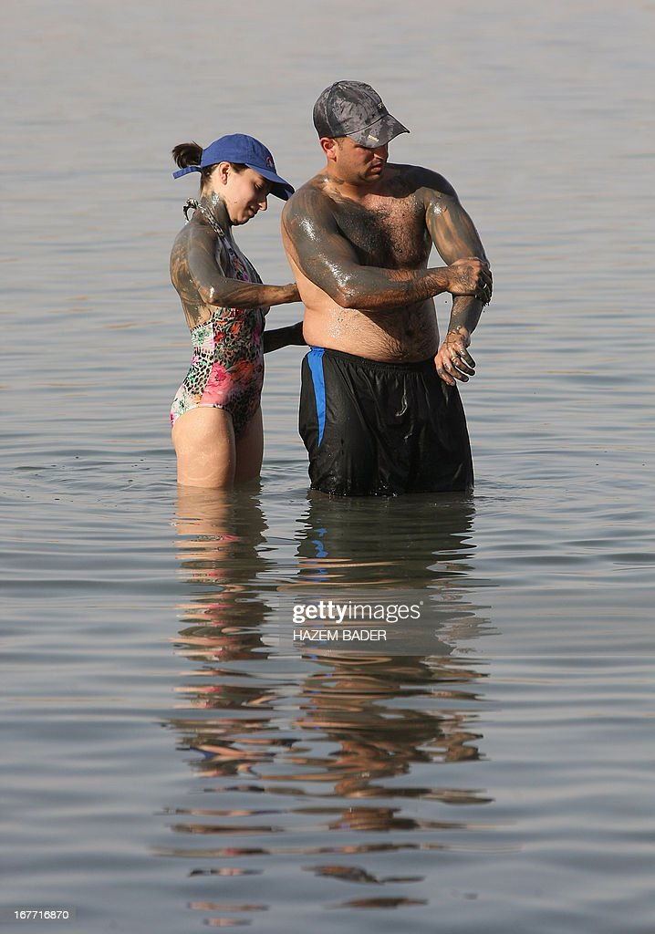 A Christian Palestinian couple enjoy the Dead Sea at the Biankini beach located along the northern shore near the city of Jericho, in the Israeli occupied West Bank, on April 28, 2013. Palestinians can access this area of the Dead Sea without an Israeli government permit.