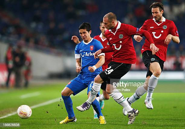Christian Pander of Hannover and Felipe Gutierrez of Twente compete for the ball during the UEFA Europa League Group L match between Hannover 96 and...
