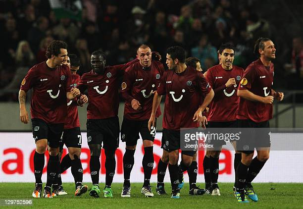 Christian Pander of Hannover celebrates with his team mates after scoring his Team's first goal during the UEFA Europa League Group B match between...
