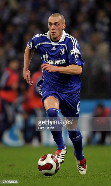 Christian Pander of Schalke runs with the ball during the friendly match between Schalke 04 and Zenith StPetersburg at the Veltins Arena on January...