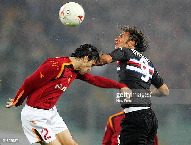 Christian Panucci of Roma attempts to control the ball from Fabio Bazzani of Sampdoria during the Serie A Roma v Sampdoria match on December 5 2004...