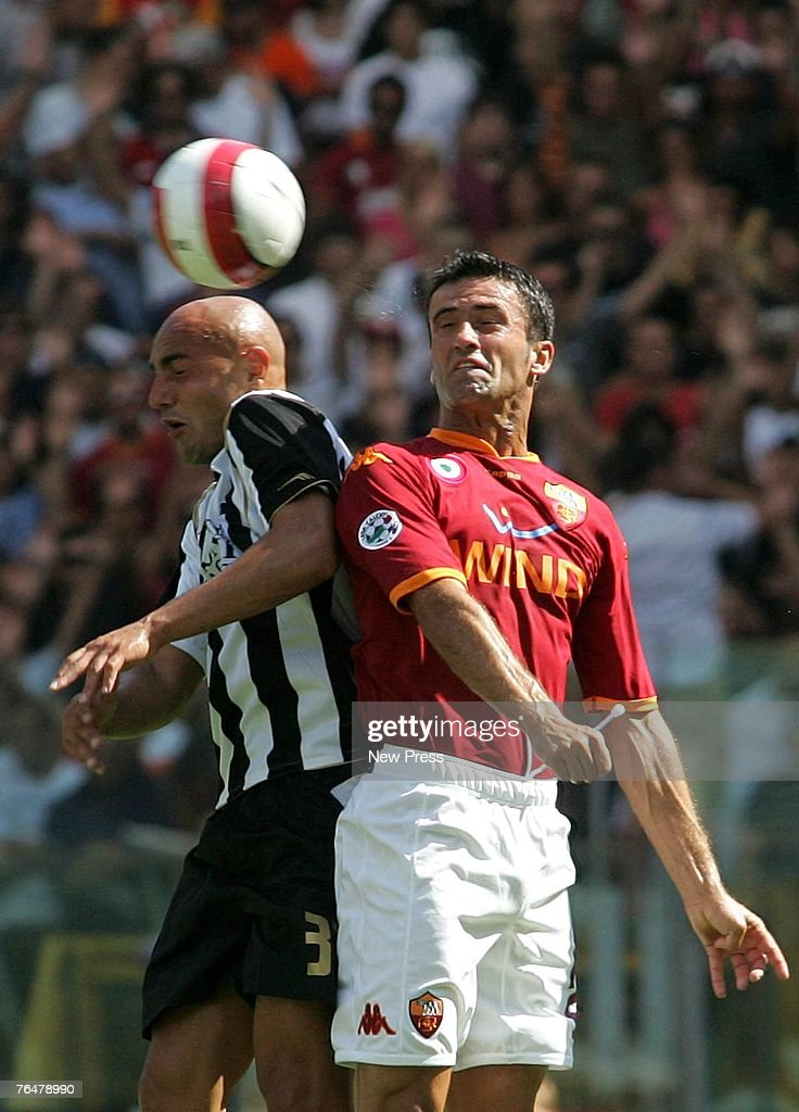 Christian Panucci of Roma battles for the ball with Massimo Maccarone of Siena during a Serie A match between Roma and Siena at the Stadio Olimpico on September 02, 2007 in Rome, Italy.