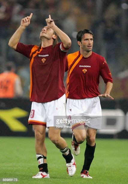 Christian Panucci of Roma celebrates the goal of Francesco Totti of Roma during the Serie A football match between Roma and Lazio at the Olympic...