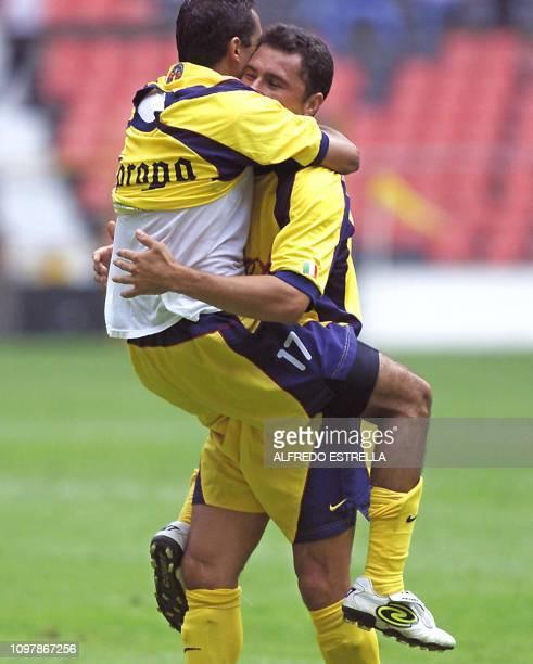 Christian Patiño of the America de Mexico team hugs teammate Raul Rodrigo Lara after they scored their third goal during the Copa Libertadores game...