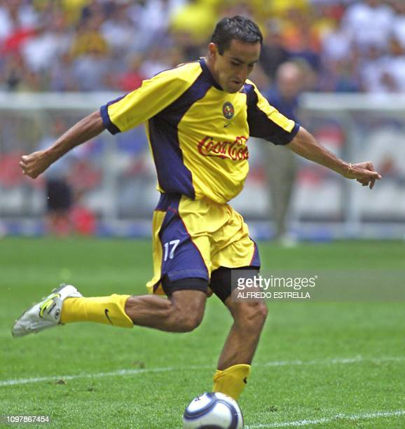 Christian Patiño of the America de Mexico team scores the third goal during the Copa Libertadores game against Cienciano de Peru 01 May 2002 in the...