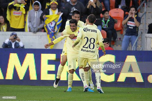 Christian Pellerano of America celebrates with teammates after scoring his team's fifth goal during a friendly match between America and Monterrey at...