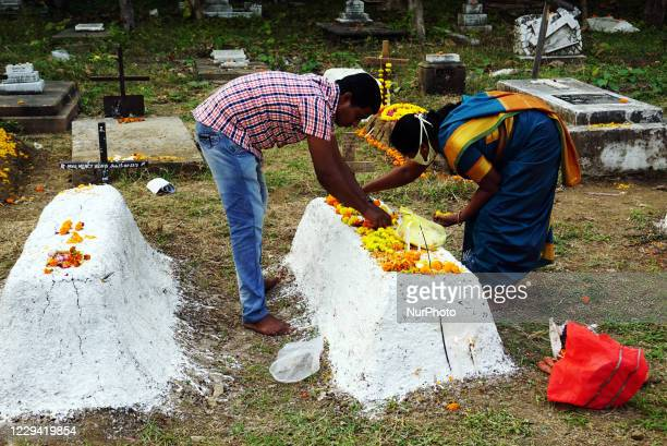 Christian people pay tribute to their family members at a cemetery during 'All Souls Day', in Nagpur, India on November 2, 2020. Due to the Covid-19...