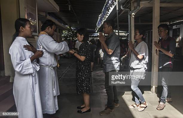 Christian people received the host when attend mass in celebration of Christmas in Sacred Heart of Jesus Catholic Church in Yogyakarta Indonesia on...
